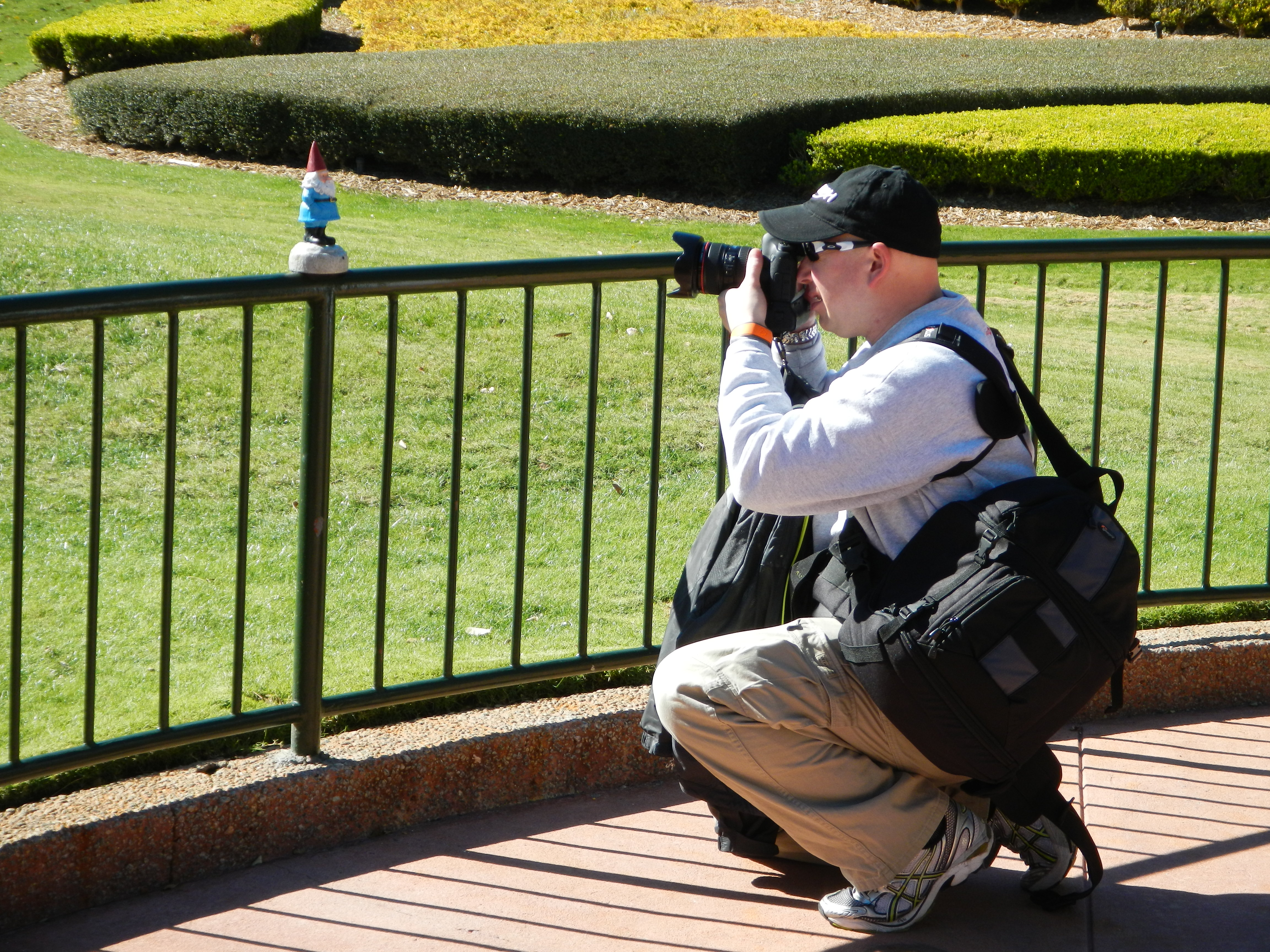 Epcot - Man taking picture of his Roaming Gnome