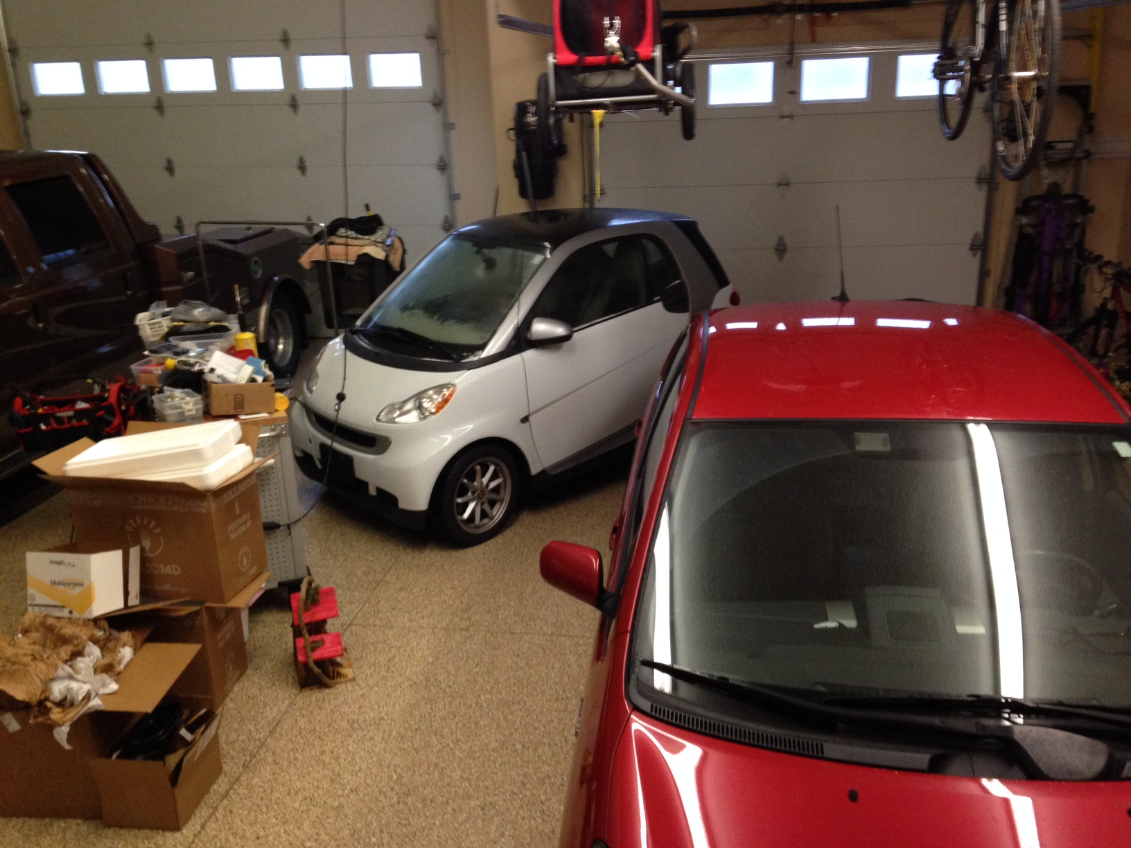 Dave and Amy's white Smart Car tucked into our garage.