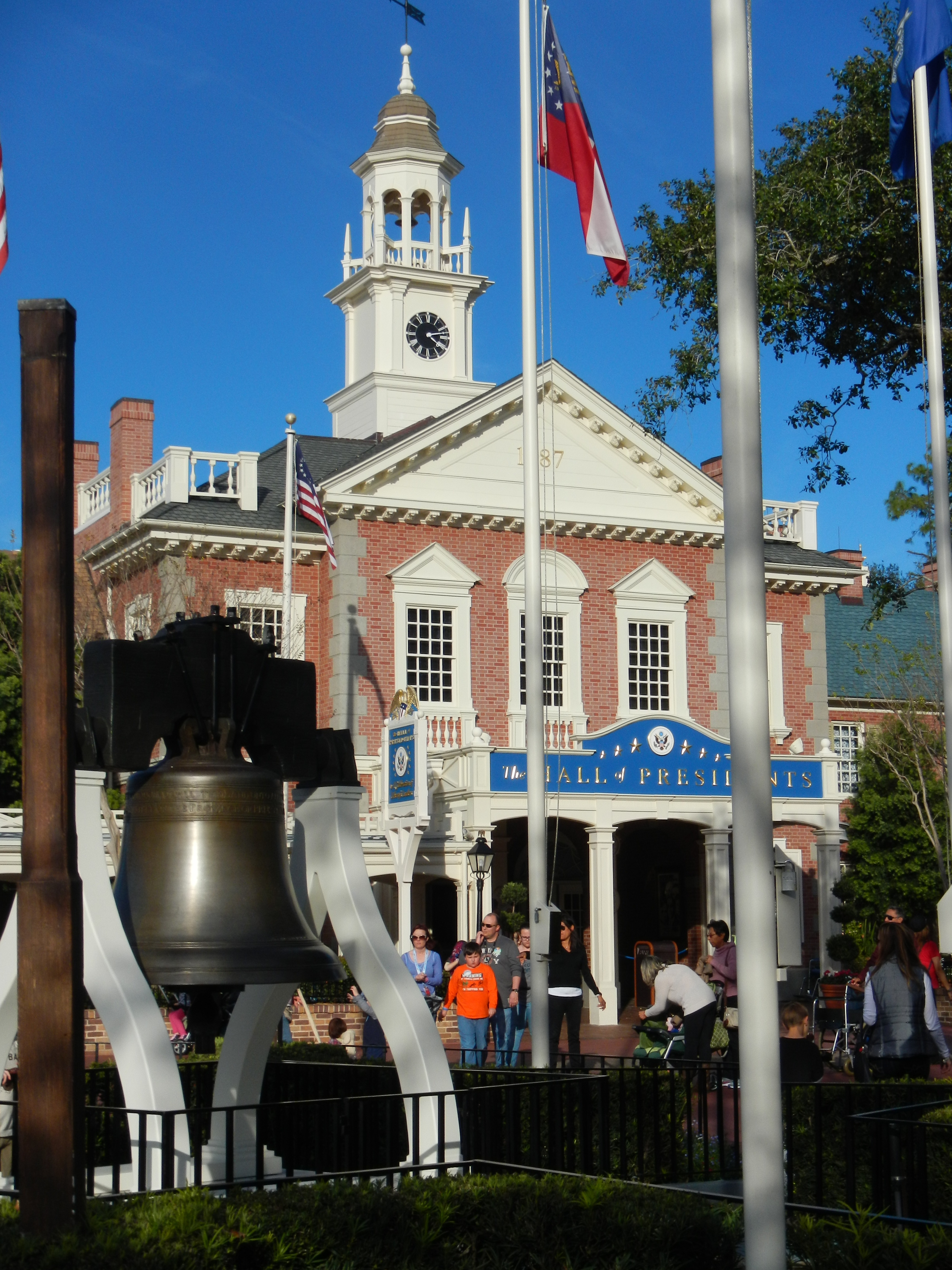 In Liberty Square.  Liberty Bell in foreground and Hall of Presidents in background.
