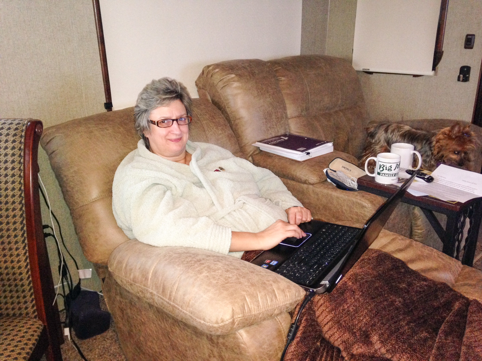 Nancy, relaxing and warm in the RV in NOLA after breakfast this morning.