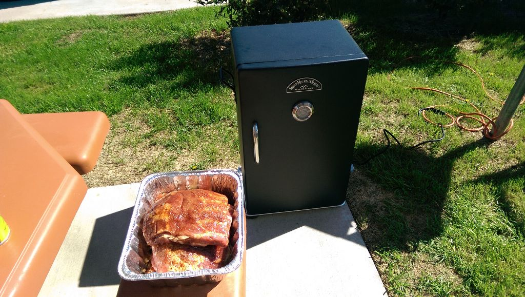 Smoker with Ribs Out in Pan
